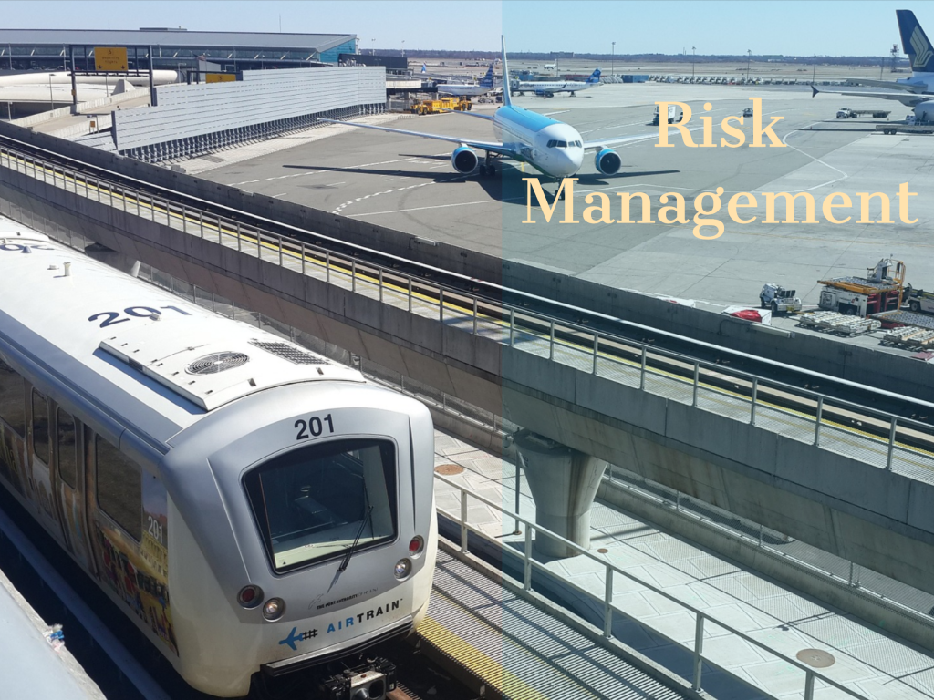 "The Air Train at JFK Airport in New York City with airplanes in the background. Captions says ""Risk Management"""